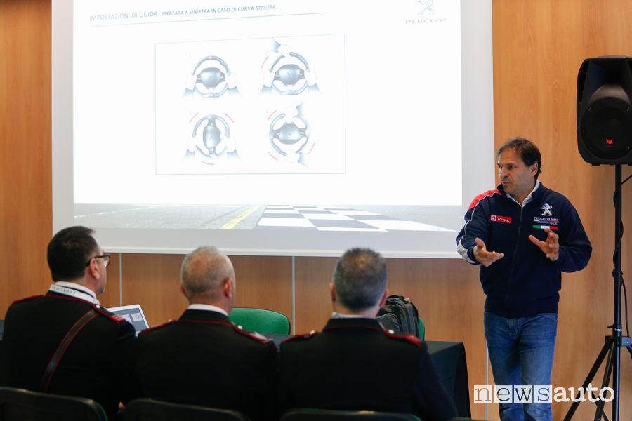 Andreucci spiega la Peugeot_308 GTi by Peugeot Sport ai Carabinieri sul circuito di Misano