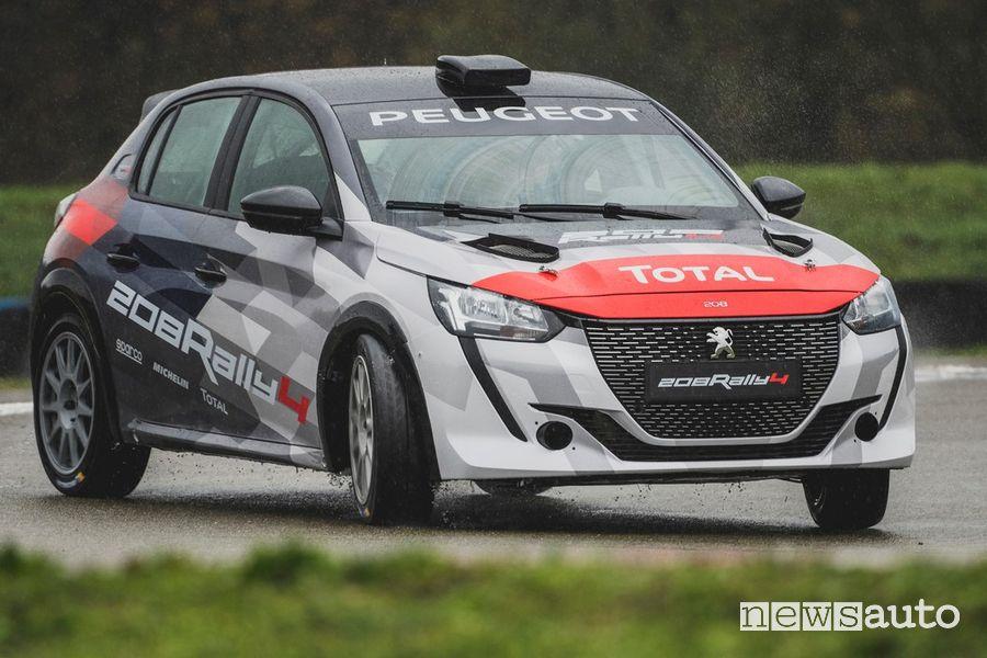 Vista anteriore, inserimento in curva Peugeot 208 Rally 4